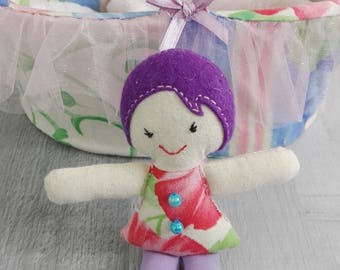 Basket with a mini doll, her pillow and cover