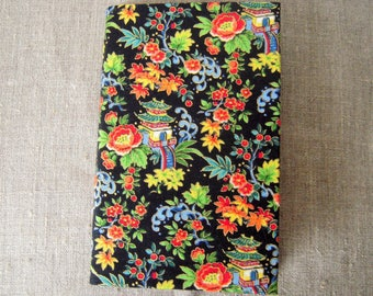 Notebook upholstered with flowers pattern