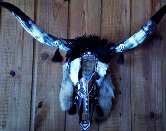 A uniquely hand  crafted longhorn Steer skull with a Native American theme.