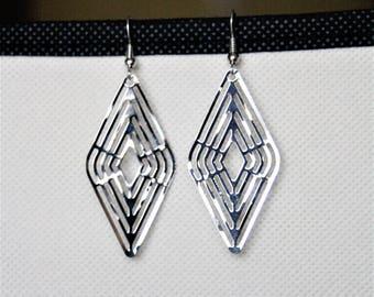 Earrings with silver metal engraving