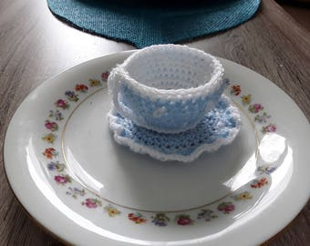 Cup and saucer with hand made crochet