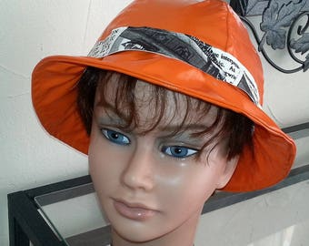 Bell shaped orange vinyl rain cap