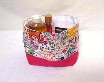 Storage basket, filled all multicolor and pink