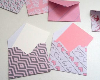 Set of small envelopes in shades of pink