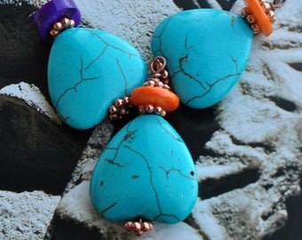 Charm pendant in turquoise and orange and purple Pearl
