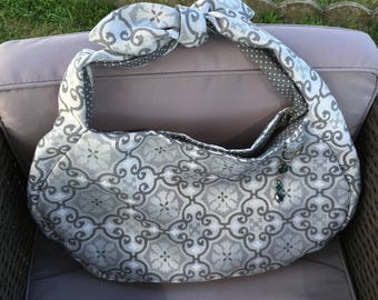 Knotted handle, mosaic art deco trend bag