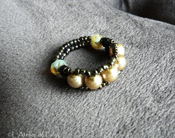Bronze ring in pearls and seed beads