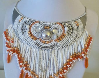 Indian breastplate. bib necklace embroidered on leather.