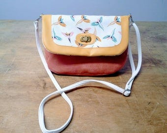Yellow faux leather shoulder bag and tissue parrots