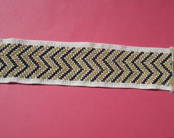 black and gold embroidered cuff