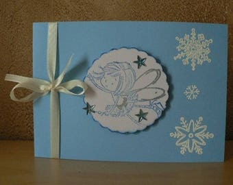 card flowing blue background and snowflakes