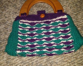 Crocheted lined clutch with wooden handles and button closure