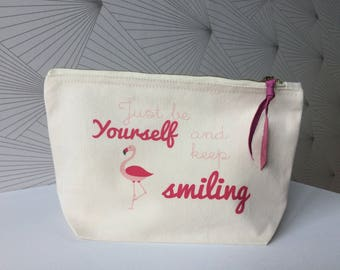 Illustrated cotton zippered pouch.