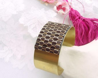 Bangle is solid raw brass and leather Brown and gold nest of bee