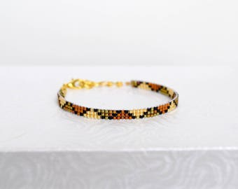 Woven bracelet Miyuki Delicas, gold plated beads and Golden beads
