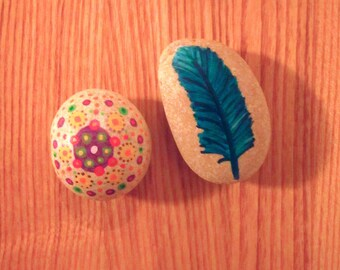 Set of two painted pebbles Bohemian mandala and feather