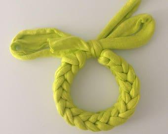 Braided bracelet handmade of green, violet