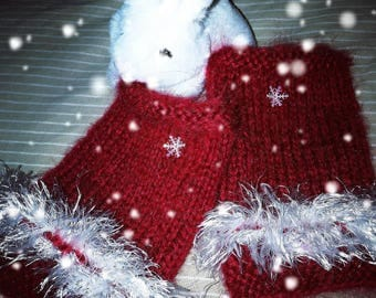 Red and white, knitted fingerless gloves by hand. Very warm and comfortable.