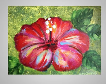 Red Hibiscus on green background