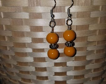 Honey yellow with large spacer bead