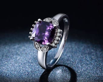 Gorgeous Amethyst and Sterling Silver (stamped) ring with a Diamond-like White Topaz accent. Retailing at 42 dollars
