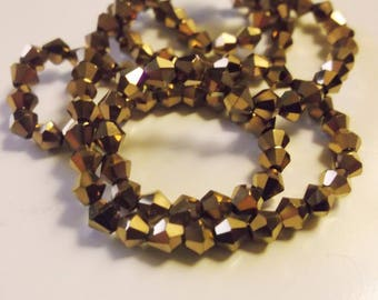 40 4mm gold glass bicone beads