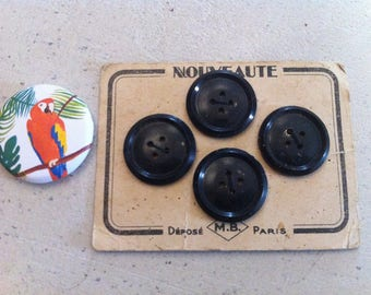 Old plate of 4 black buttons