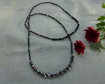 Vintage seed necklace - black, small faceted silver tubes.