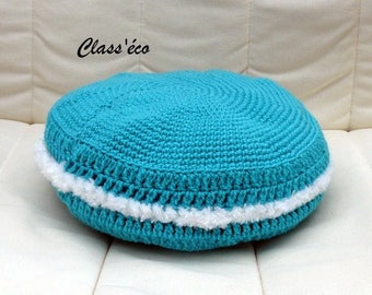 giant button crocheted in turquoise wool