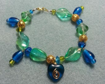 Grea, blue, and gold bracelet