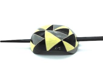 Yellow, black and gray hair pin