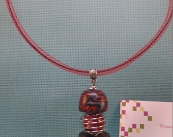 §49§ pendant in polymer clay on bail with 2 half spheres black and Red