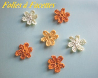 Crocheted in cotton yellow and orange flowers