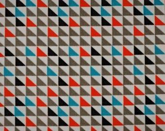 White, turquoise, orange triangle geometric pattern cotton fabric