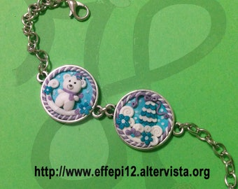Winter: bracelet with polar bear and snowy landscape