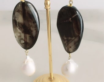Long Chanel earrings with baroque pearls. Earrings in silver gold and hard stones. Pendants with pearls. Earrings with Onyx. Gift woman.
