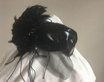Black feathered masquerade mask