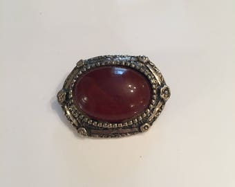 Vintage silver tone brooch with red stone