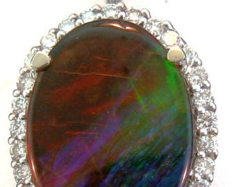 Large Rainbow Ammolite and Diamond Pendant set on 14k White Gold.