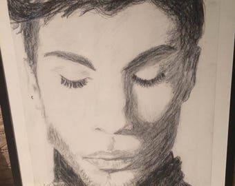 Prince drawing from picture in Time.