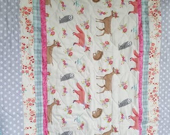 Striped Woodland creature patterned baby quilt w/ turtle backing