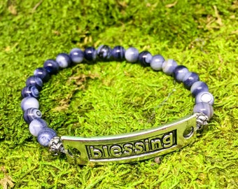 Blessing stretch bracelet with shades of blue beads