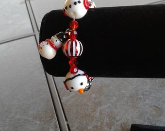 Red, green & silver bracelet with snowmen