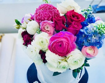 Hat box style arrangement small to wow size   Florists Choice