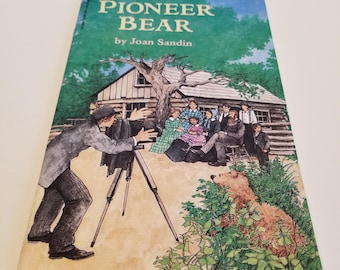 Pioneer Bear Based on a True Story by Joan Sandin, First Scholastic Printing, January 1997