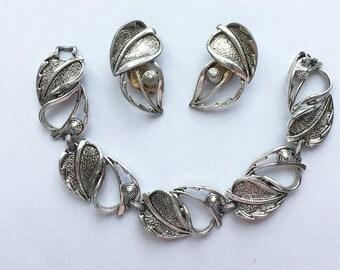 Vintage Sarah Coventry clip on earrings and matching bracelet - modern leaf design