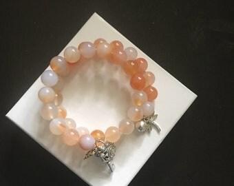 Carnelian bracelet with charms