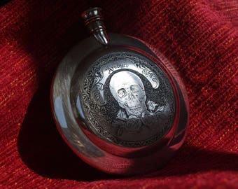 Hand-engraved pewter flask.