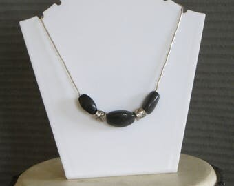 three black stones necklace
