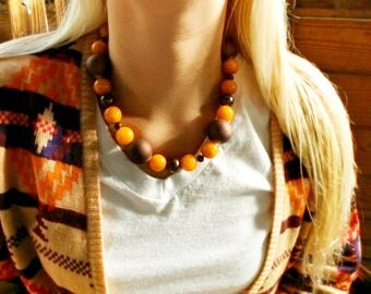 orange agate, brown feshwater pearls, brown foil pearls, brown rubber coated beads, copper toggle clasp, N27